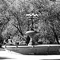 The Fountain And The Ride In Black And White by Rob Hans