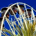 The Magic Ferris Wheel Ride by Mariola Bitner