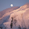 The Moon Rises Over Snow-blown Peaks by Bill Curtsinger