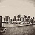 The New York City Skyline And The Brooklyn Bridge by Vivienne Gucwa