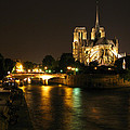 The Seine And Notre Dame At Night by Greg Matchick