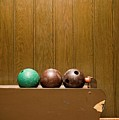 Three Bowling Balls In Bowling Alley by Benne Ochs