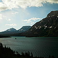Three Mountains On Many Glacier Lake by Jeff Swan