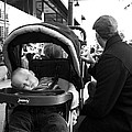 Tired Child Sleeping In Baby Stroller With Dad by Gray  Artus