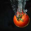 Tomato Falling Into Water by Ted Kinsman