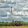 Tractor And Old Windmill by Brian Mollenkopf