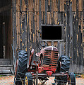 Tractor And The Barn by Donna Greene