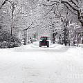 Tractor Driving Down A Snow Covered Road by Richard Thomas