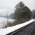Train Tracks In Snowy Landscape by Roberto Westbrook