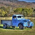 Truck In A Field by Dennis Clark