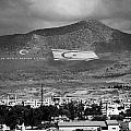 Turkish Symbols And Turkish Cypriot Flags In Besparnak Mountain Overlooking Nicosia Cyprus by Joe Fox