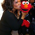 Tv Host Oprah Winfrey And Friend Elmo by Everett