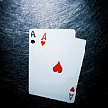 Two Aces Playing Cards On Stainless Steel. by Ballyscanlon