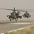 Two Ah-64 Apache Helicopters Prepare by Terry Moore