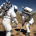 Two Astronauts Collect Soil Samples by Stocktrek Images