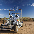Two Astronauts Take A Ride On Scout by Stocktrek Images