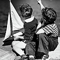 Two Boys Playing W/sailboats by George Marks