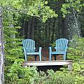 Two Chairs Sit At A Lakeside Camp by Heather Perry