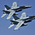 Two Fa-18c Hornets In Flight by Stocktrek Images