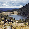 Two Horsemen Ride Above Pecos Baldy by Justin Locke