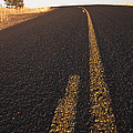 Two Lane Road Between Fields by Jetta Productions, Inc