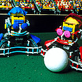 Two Lego Footballers With A Ball At Robocup-98 by Volker Steger