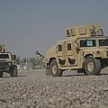 Two M1114 Humvee Vehicles At Camp Taji by Stocktrek Images