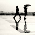 Two Men In Rain With Their Reflections by Nadia Draoui