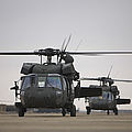 Two Uh-60 Black Hawks Taxi by Terry Moore