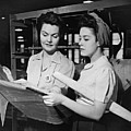 Two Women In Workshop Looking At Blueprints, (b&w) by George Marks