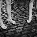 Two Young Women Wearing High Heeled Shoes And Fake Tan On Cobblestones On A Night Out In Dublin  by Joe Fox