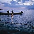 Ugandan Men Using Nets And Lanterns by Michael S. Lewis