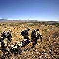 U.s. Air Force Pararescuemen Carry by Stocktrek Images