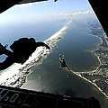 U.s. Airmen Jump Out Of A C-130 by Stocktrek Images