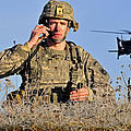 U.s. Army Captain Directs An Ah-64 by Stocktrek Images