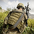 U.s. Army Mk48 Machine Gunner Patrols by Stocktrek Images