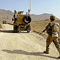 U.s. Army Soldier Moves To His Mrap by Stocktrek Images