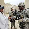U.s. Army Soldier Shakes Hands With An by Stocktrek Images