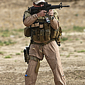 U.s. Contractor Firing A M4 Carbine by Terry Moore
