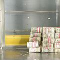Us Dollar Bills In A Bank Cart by Adam Crowley