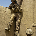 U.s. Marine Climbs Down From An by Stocktrek Images