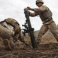 U.s. Marine Drops A Mortar Round by Stocktrek Images