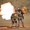 U.s. Marine Fires A Rpg-7 Grenade by Terry Moore