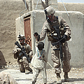 U.s. Marine Gives An Afghan Child by Stocktrek Images