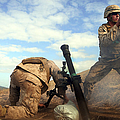 U.s. Marine Holds A Mortar Tube Steady by Stocktrek Images