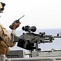 U.s. Marine Talks On A Radio While by Stocktrek Images