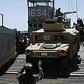 U.s. Marines Load An M1114 Humvee Onto by Stocktrek Images