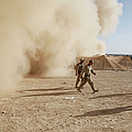 U.s. Marines Walk Away From A Dust by Stocktrek Images