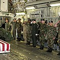 U.s. Military Personnel Salute The Flag by Everett