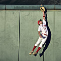 Usa, California, San Bernardino, Baseball Player Making Leaping Catch At Wall by Donald Miralle